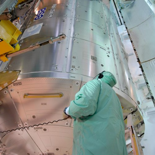 The European Columbus laboratory is transferred into Space Shuttle Atlantis payload bay