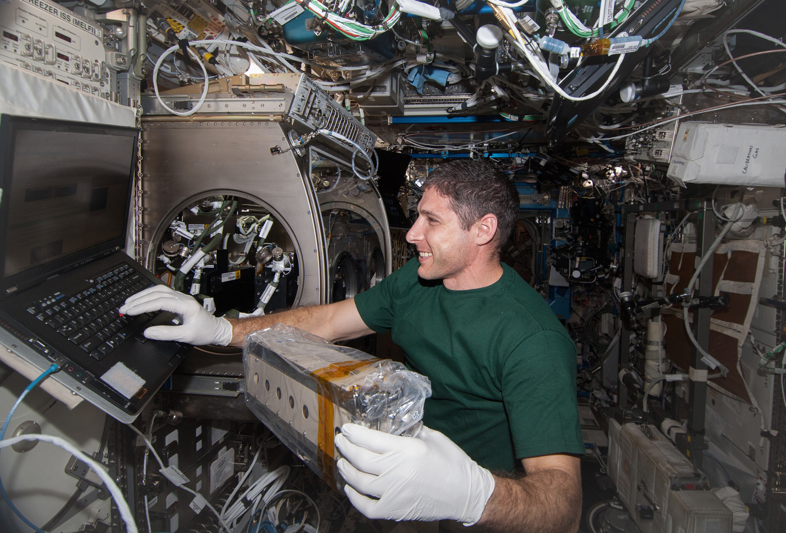 Astronaut Mike Hopkins installing the Cell Array for SODI-DCMIX2